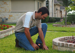 one of our Mira Mesa sprinkler repair techs is fixing a broken head